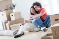 Couple moving in young multi ethnic resting while into their new home Stock Image