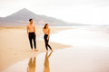 Couple with naked torso on the beach Royalty Free Stock Photo