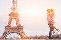 Couple near Eiffel tower, love, honeymoon in Paris Royalty Free Stock Photo