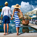 Couple near poolside jetty at seychelles Royalty Free Stock Image