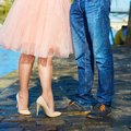 Couple near the Seine in Paris, closeup on legs Royalty Free Stock Photo
