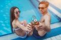 Couple near swimming pool