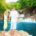 Couple near waterfall Royalty Free Stock Photography