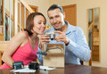 Couple with new compact digital camera Royalty Free Stock Photo
