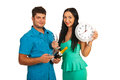 Couple at new year party happy with champagne showing midnight time isolated on white background Stock Photography