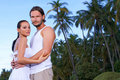 Couple nex to Palm tree Royalty Free Stock Photography