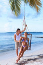 Couple next to Palm tree Royalty Free Stock Images