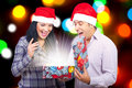 Photo : Couple open a magic Christmas gift   hands