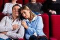 Couple and other people in cinema Stock Images