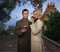 Couple outdoors elegant with cups of hot drink Stock Photography