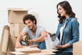 Couple packing cardboard box portrait of happy young boxes Royalty Free Stock Photography