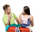 Couple packs suitcase with clothing for departure isolated on white concept of romantic vacations and lovely honeymoon Stock Photo