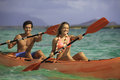 Couple paddling their kayak Royalty Free Stock Photo