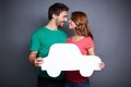 Couple with paper car portrait of young holding and looking at one another Royalty Free Stock Photos