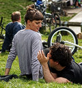 Couple at the park sit on grass and enjoy sunny weekend in clissold london Royalty Free Stock Image