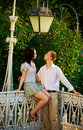 Couple in a park under old streetlamp Royalty Free Stock Photos