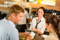Couple paying bill at cafe cash desk Royalty Free Stock Photo