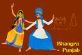 Couple performing Bhangra folk dance of Punjab, India