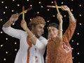 Couple performing Dandiya Raas on Navratri
