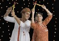 Couple performing Dandiya Raas on Navratri