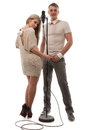 Couple performs duet singing microphone over white Stock Images
