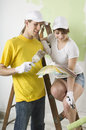 Couple picking wall paint colors Stock Images