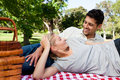 Couple picnicking in the park Stock Photos