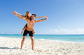 Couple piggy back ride at the beach Royalty Free Stock Photo