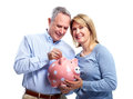 Couple with piggy bank happy senior isolated over white background Royalty Free Stock Images