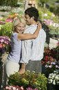 Couple at plant nursery hugging Stock Photos