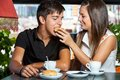 Couple playing around at breakfast close up portrait of teen fooling in coffee bar Royalty Free Stock Photos