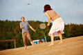 Couple playing badminton at beach happy together in summer Royalty Free Stock Photo