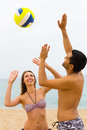 Couple playing with a ball on the beach Royalty Free Stock Photo
