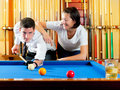Couple playing billiard expertise teacher Stock Photos