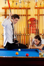 Couple playing billiard expertise teacher Royalty Free Stock Images