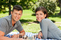 Couple playing chess in the park Royalty Free Stock Photo