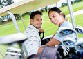 Couple playing golf happy in a cart Stock Photos