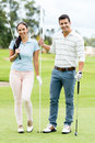 Couple playing golf happy at the course Stock Photo