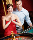 Couple playing roulette wins Stock Photo