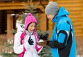 Couple playing at snowballs and having fun outdoors during winter vacations Stock Photography