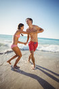 Couple playing in water Royalty Free Stock Photo