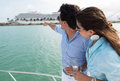 Couple pointing at a cruise summer on the boat Royalty Free Stock Image