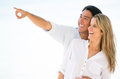 Couple pointing far away Royalty Free Stock Photo