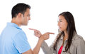 Couple pointing fingers at each other blaming each other for problem two people isolated on white background Royalty Free Stock Images