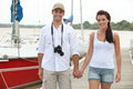 Couple on a pontoon walking along Royalty Free Stock Photography