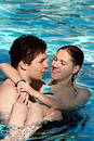Couple in the pool Royalty Free Stock Photo