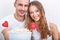 Couple with pop corn ad heart symbols valentines day symbols Stock Photography