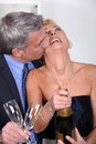 Couple popping a champagne cork Royalty Free Stock Photo
