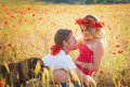 Couple on the poppy meadow Royalty Free Stock Photo