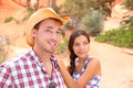 Couple portrait in american countryside outdoors smiling multiracial young western usa nature man wearing cowboy hat and Stock Photos